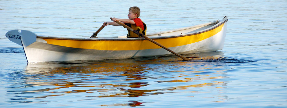 boy rowing a boat