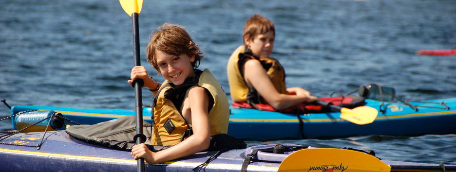 Boys learn to kayak at Pine Island Camp.