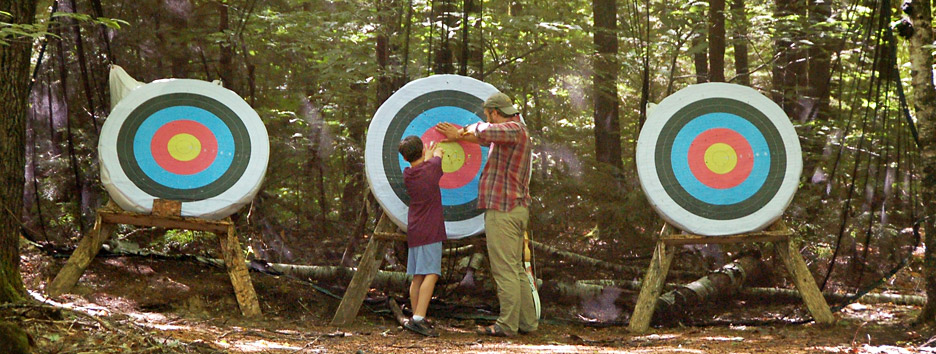 An archery lesson at Pine Island Camp, a boys summer camp in Maine.