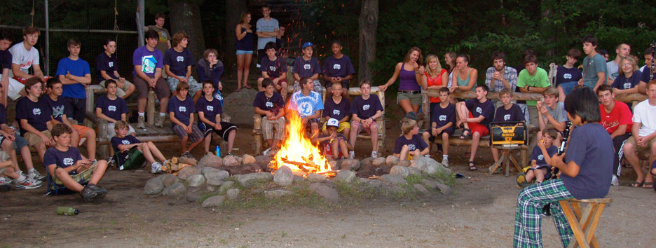 Campers at Pine Island Camp enjoying a nightly campfire.